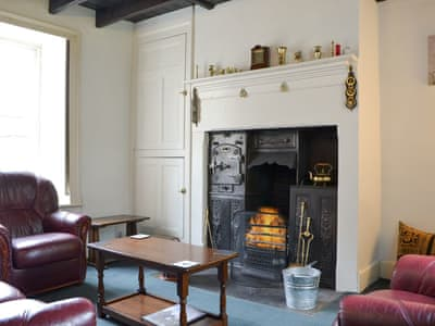 Cosy living room with open fire | Gilmore House, Alston