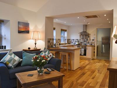 Tastefully decorated open plan sitting/dining room and kitchen | The Old Dairy, Leadgate, near Alston