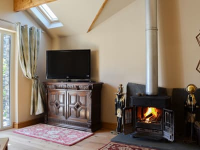 Cosy living room with access to the garden | Stonecroft Cottage, Broughton-in-Furness, near Barrow-in-Furness