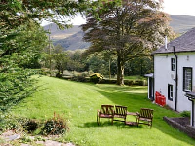 Beautiful gardens with sitting out areas | Jose's at the Grange, Loweswater