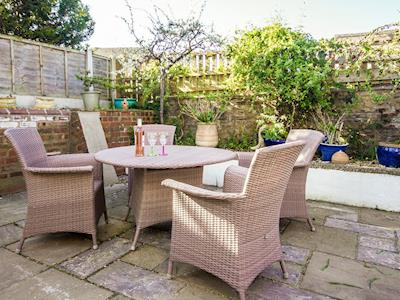Enclosed paved patio with outdoor furniture | Orchard Leigh, Carlisle