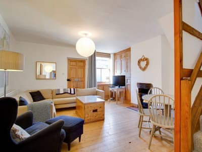 Comfortable living and dining room with wood burner | Buddy's Cottage, Kendal