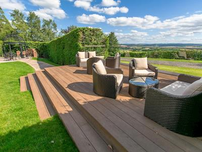 Decked seating area in the garden and grounds | The Mews @ Roundthorn, Roundthorn, near Penrith