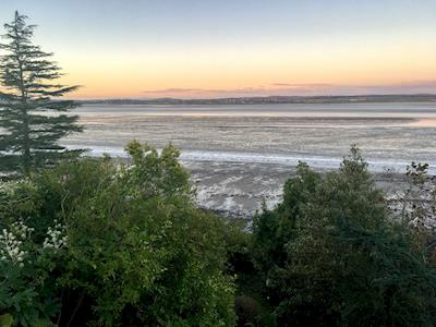 Stunning sunset view from the upstairs bedroom | Bank Cottage, Bowness-on-Solway