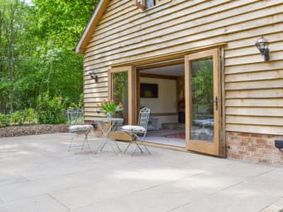 Attractive patio area of a lovely detached barn conversion | The Old Coach House, West Grinstead, near Horsham