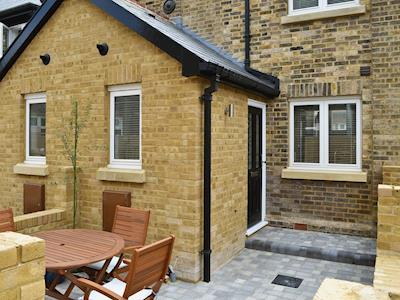 Small enclosed courtyard with garden furniture | Old School Mews, Broadstairs