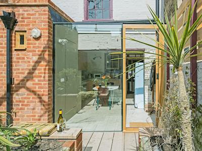 Courtyard with sitting-out area & furniture | Smugglers Cottage, Margate