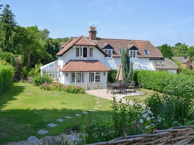 Large lawned garden with paved area for alfresco dining | Keepers Cottage - Shappen Cottages, Burley