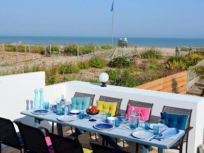 Enclosed garden with patio, garden furniture and firepit | The Beach Hive, Pevensey Bay, near Eastbourne