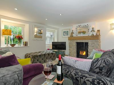 Stylish living area with wood burner | Rose Cottage, Mere