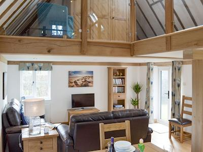 Open living and dining area with galleried dressing area above | Pickdick Stable, Brede, near Rye