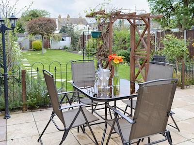 Paved patio with outdoor furniture | Belmont Cottage, Sheerness, Isle of Sheppey