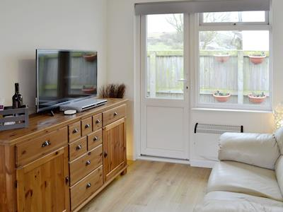 Charming open plan living space | Chalet One, Bridport
