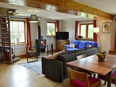 Beautifully presented open plan living space with cosy multi-fuel burner | The Old Dairy - North End Farm Cottages, Chideock, near Bridport
