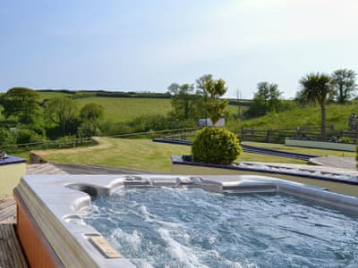 Luxurious hot tub with fantastic view | Pentire, Holbeton, near Ivybridge