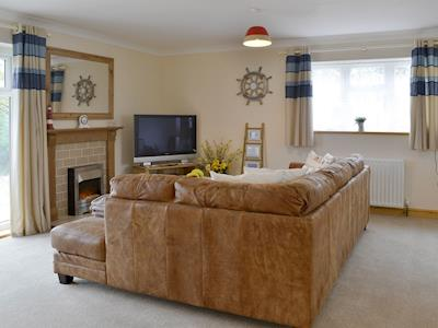 Cosy seating area within spacious open-plan living space | Swallows Rest, East Taphouse, near Liskeard