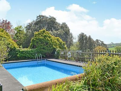 Wonderful outdoor heated swimming pool (shared with owner and other properties on-site) | Cloisters Cottage - Peregrine Hall Cottages, Lostwithiel