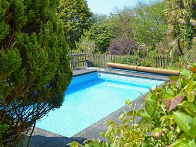 Outdoor heated swimming pool (shared with owner and other properties on-site) | Stable End - Peregrine Hall Cottages, Lostwithiel