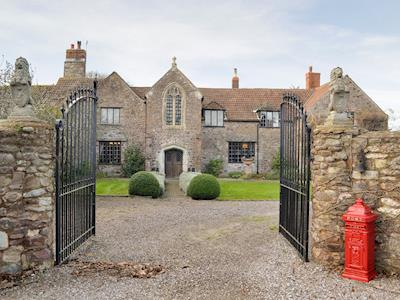 Grand entrance to an outstanding holiday home | The Old Manor, Dunster, near Minehead