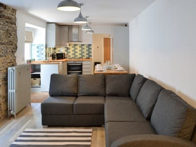 Spacious living area with contemporary lighting | Rosetta ApartmentsOcean Mist, Newquay