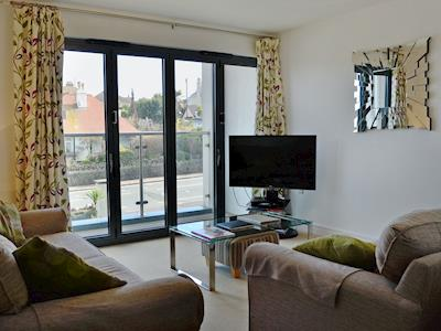 Beautifully presented living room with bi-fold doors leading to balcony | Beaches, Torquay