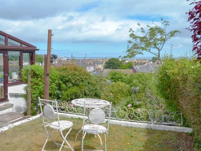 Stunning sea views from the garden | Orchard Hill House Apartment, Paignton
