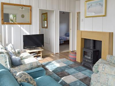 Attractive living area with wood burner | Lodge Number 12A, Seaton