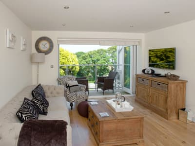 Light and airy living area with bi-fold doors to balcony | 6 Sandy Lane, Carbis Bay, near St Ives
