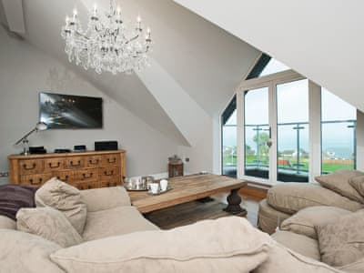 Tastefully modernised living area with amazing sea views | 7 Four Seasons Penthouse, Carbis Bay, near St Ives