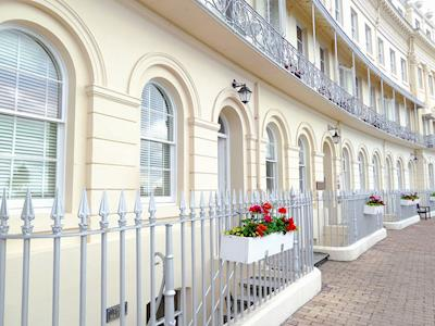 The property is part of a row of palatial town houses looking out over the sea | Regency Apartment, Torquay