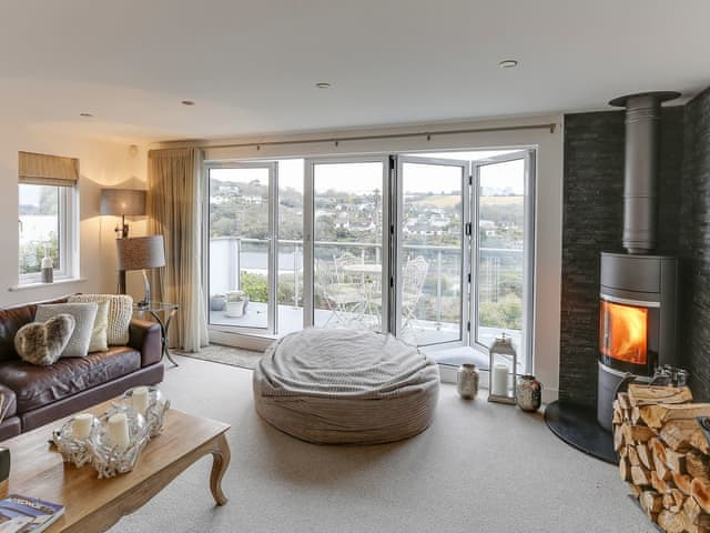 Spacious living room with wood burner overlooking the creek | Wingletang, Penpol, near Truro