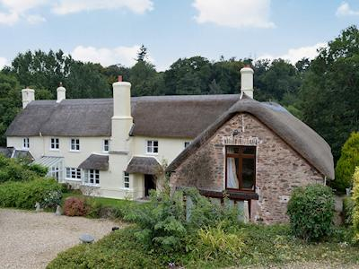 Thatched former stables converted into split level luxury accommodation | Grooms Lodge - Glasses Farm Cottages, Roadwater