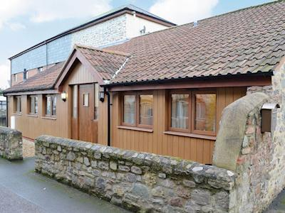 Wood-clad exterior of the ground-floor accommodation | Low Barn - Croft Cottages, Watchet