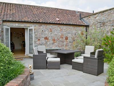 Outdoor furniture in lower courtyard | The Piggery, Dulcote, Wells