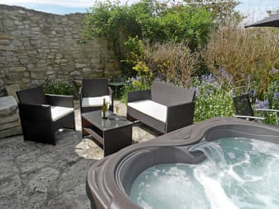 Inviting, private hot tub | Guillemot Cottage, Portland, near Weymouth