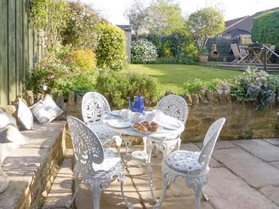 Paved patio with outdoor furniture | Eastnor Villa, Martock, near Yeovil