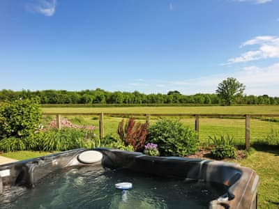 Inviting hot tub with fantastic views | Midknowle Barn - Midknowle Farm Cottages, South Barrow, near Yeovil