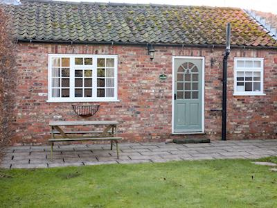 Holiday cottage with sitting out area on patio | Moore - Claxton Grange, Claxton, near York