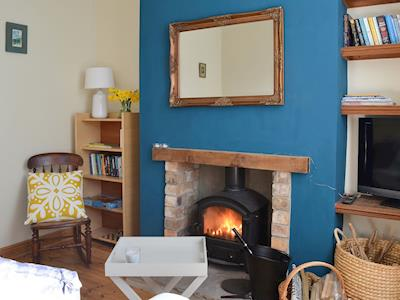 Attractive living room with wood burner | Seaside Cottage, Scarborough