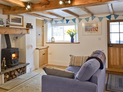 Charming living room with wooden beams and wood-burning stove | The Old Dairy, Scarborough