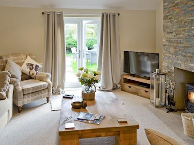Spacious lounge with French doors leading to garden | Willow Tree Cottage at Cottage Farm, Foxholes, near Scarborough